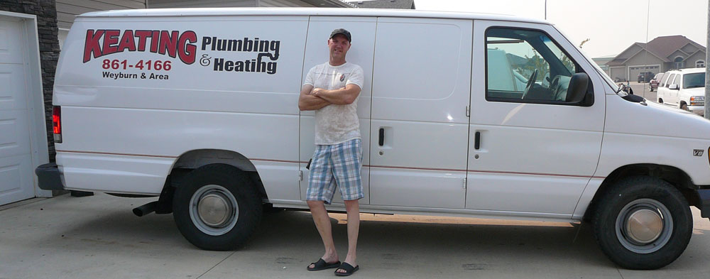 Man Standing in Front of Keating Plumbing & Heating Van